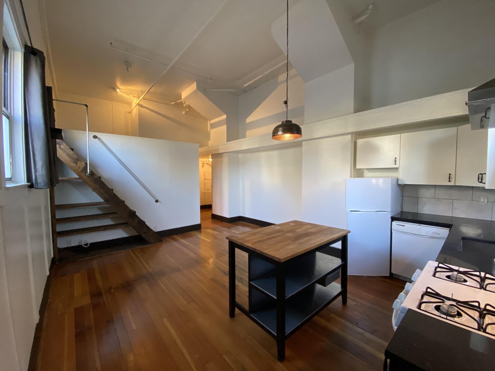 Unique Townhouse-Style 1 bed + Loft! FREE Utilities!